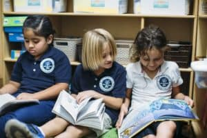 Creation Village Preparatory students reading together in the classroom